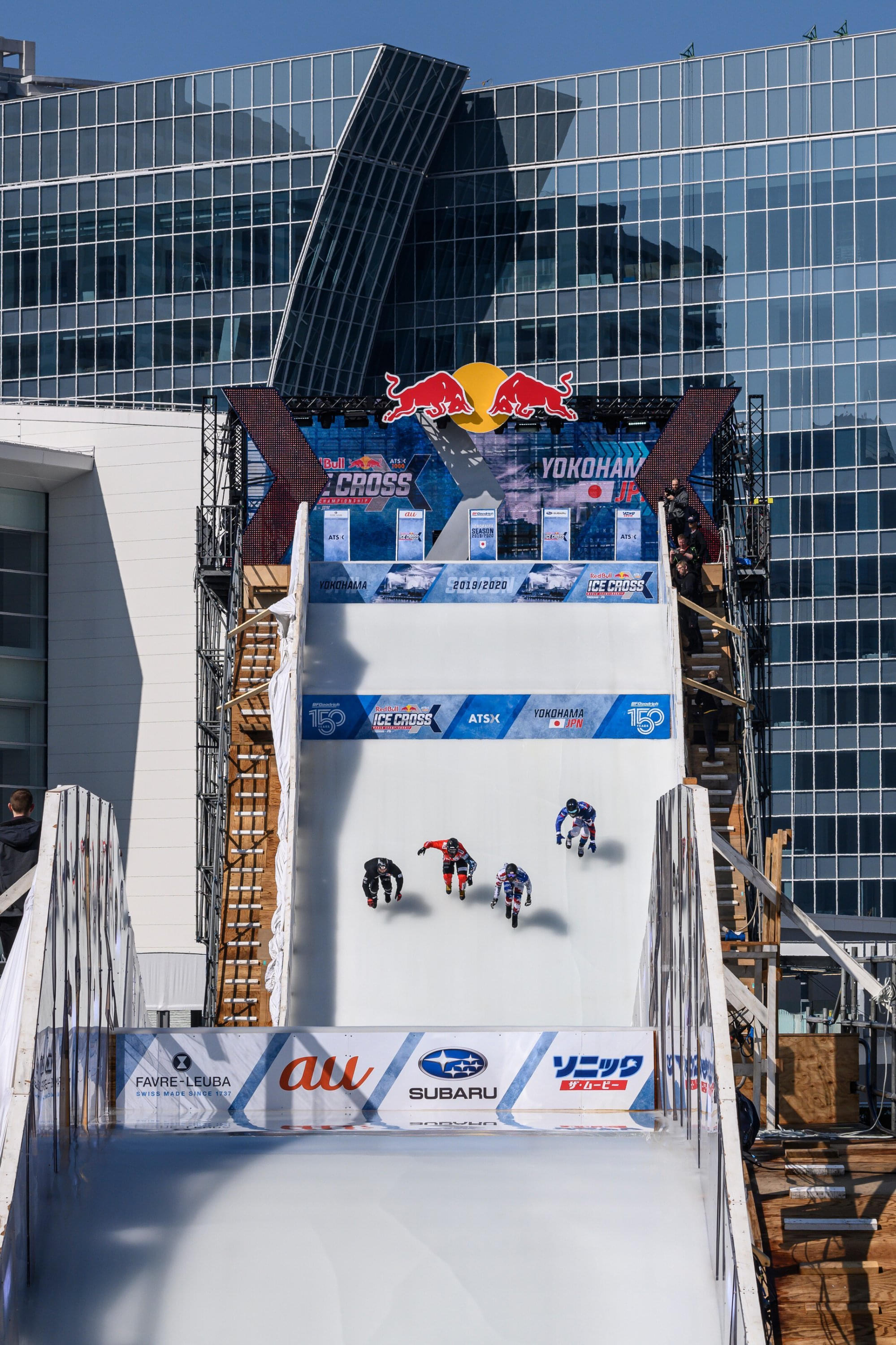 Riders drop in to the steep starting straight heading to the Reiwa Booster. Image: Joerg Mitter / Red Bull Content Pool